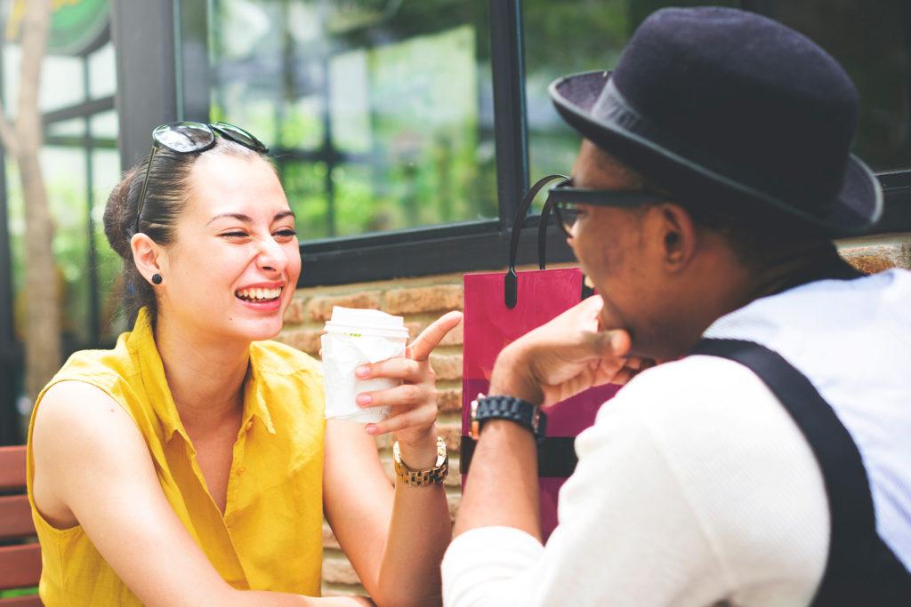 Couple sitting laughing - great communication skills