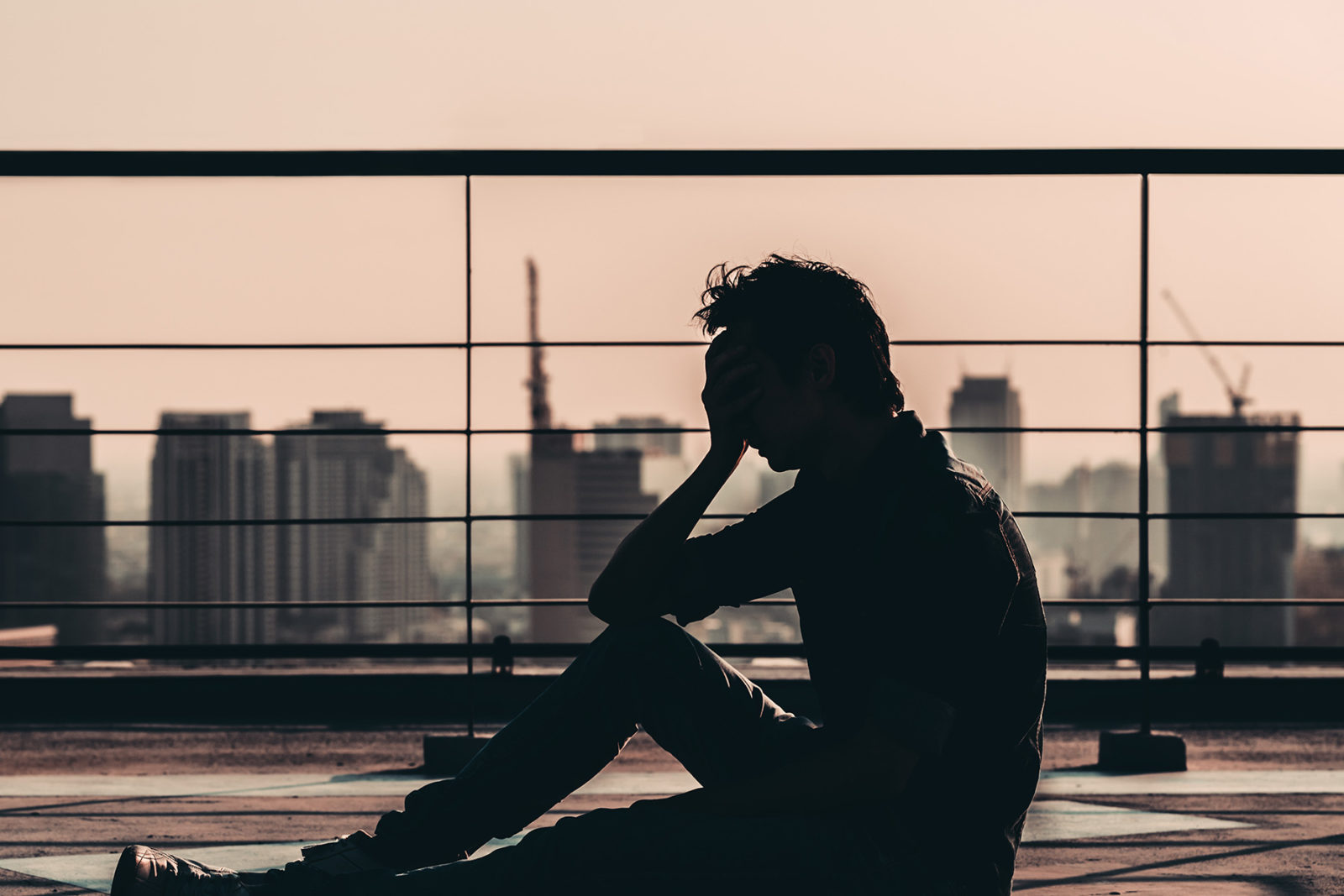 Man sitting with head in hands suffering depression