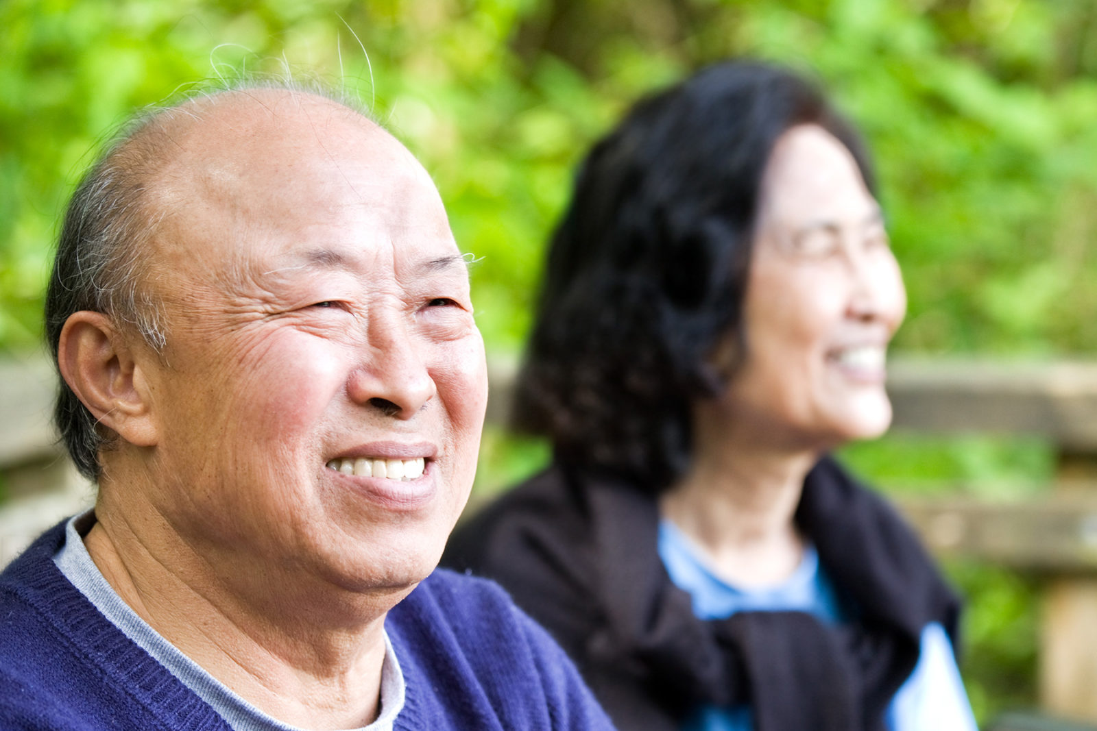 Older couple laughing and talking with their family