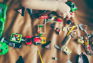 Changing face of fatherhood - kids toys strewn across a bedroom floor