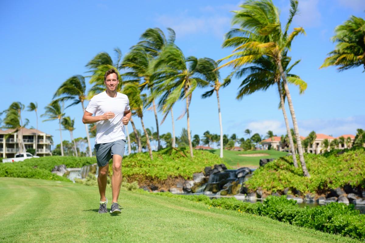 Happy man jogging