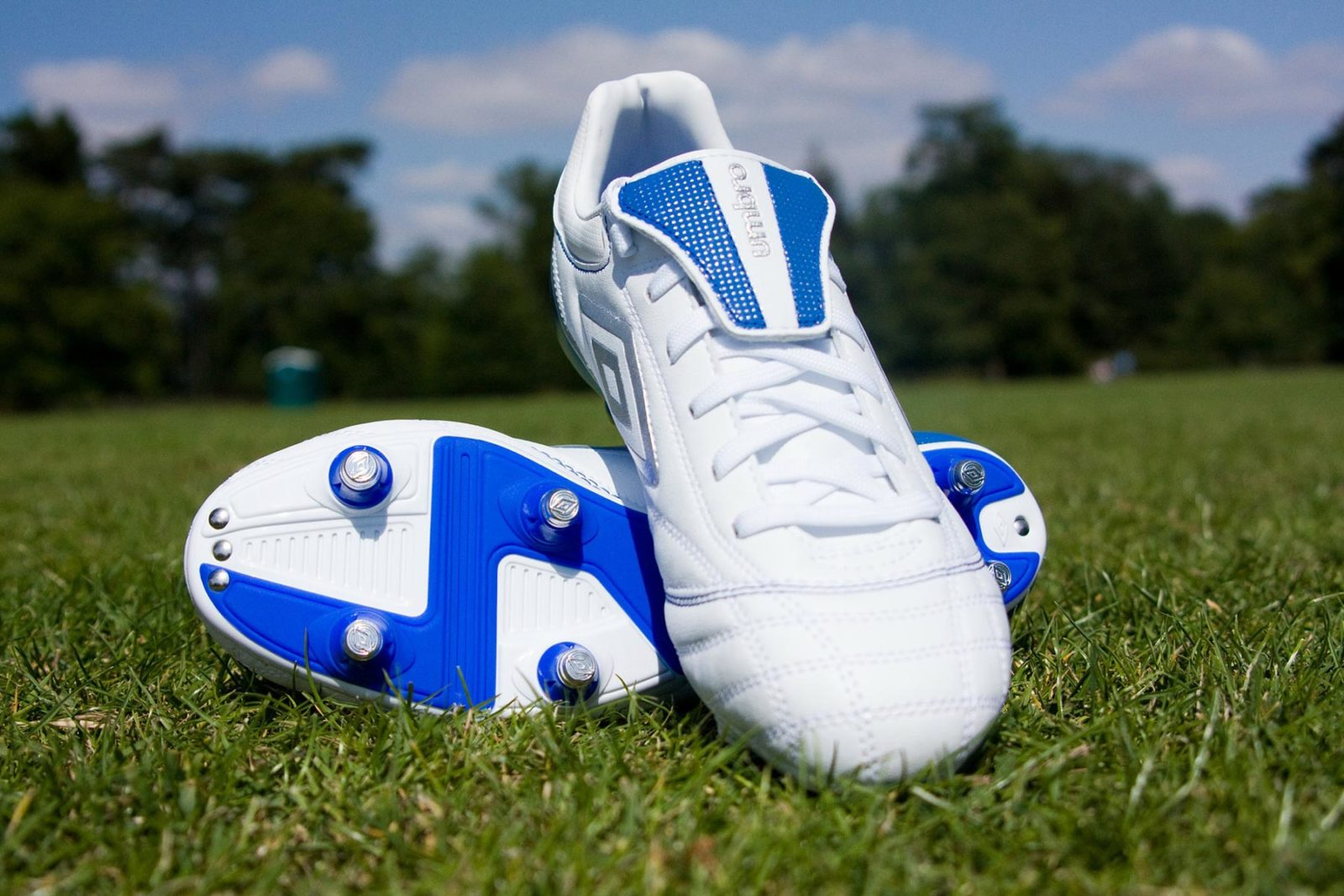 Pair of footy boots on a grass field