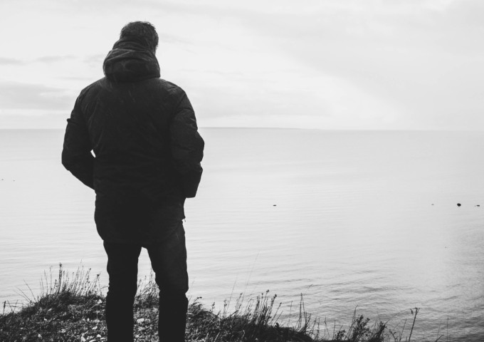 Man standing alone in a field