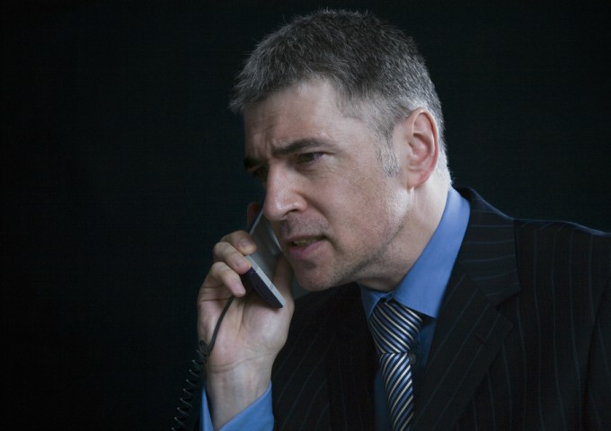 What is high functioning anxiety? Businessman on phone