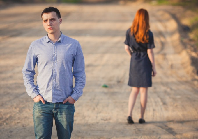 Man and woman facing different directions - relationship separation