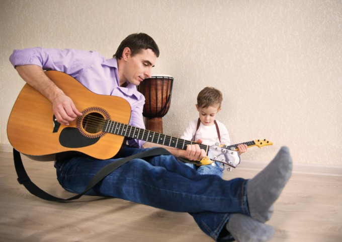 Father & son playing music - Songs celebrating fatherhood