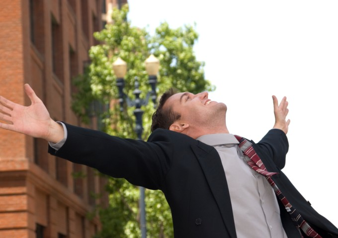Man happy, throwing his arms out wide