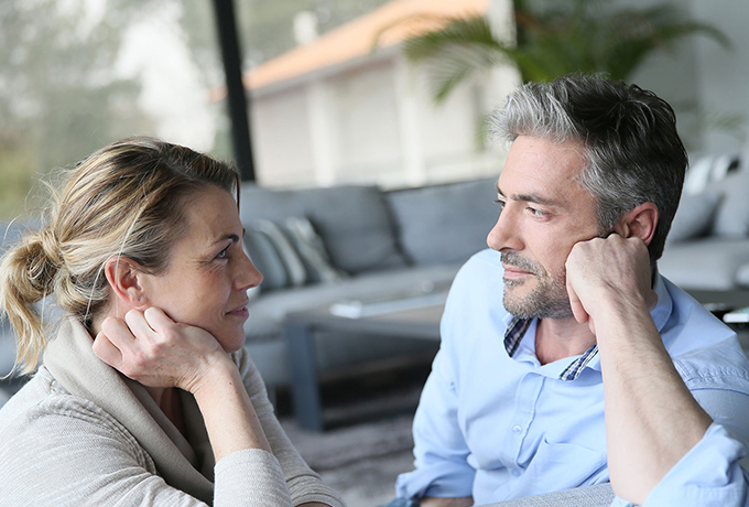 Couple sat together talking and listening to one another