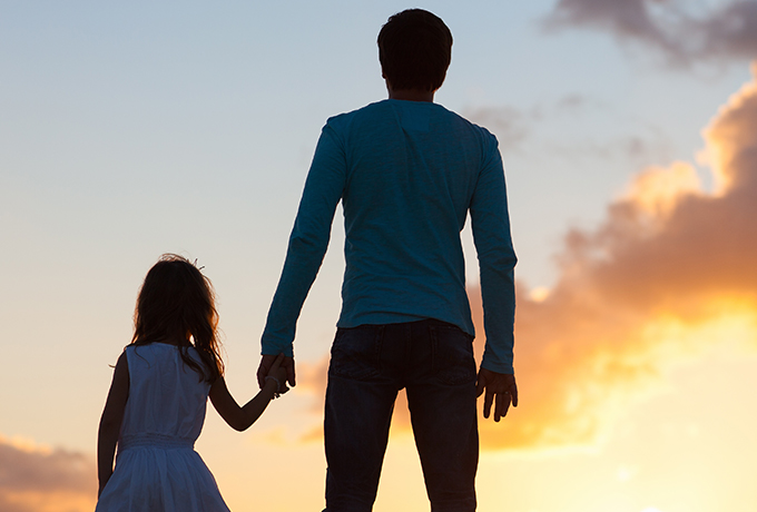 Father's day - father and daughter watching sunset