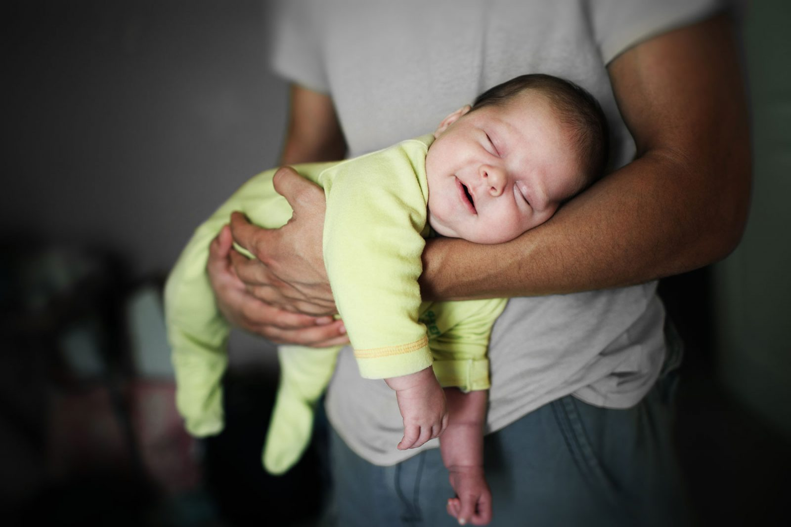 Baby sleeping in fathers arms