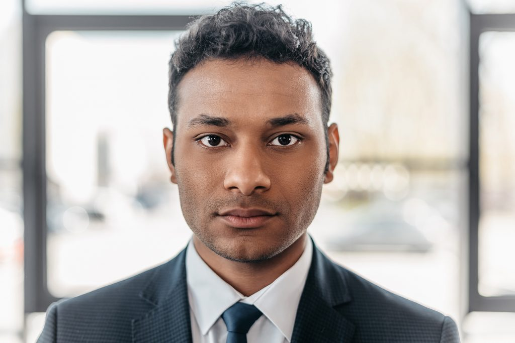 Man in a suit looking at camera