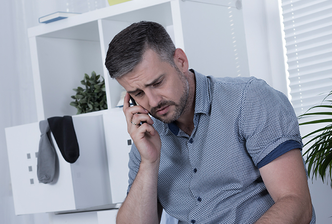 Man upset talking on the phone