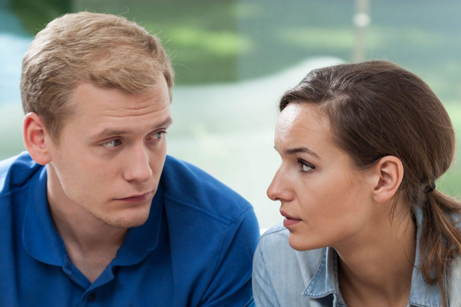 Couple sat arguing about money