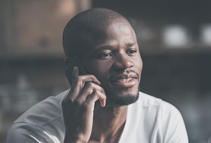 Man calling MensLine Australia talking on the phone