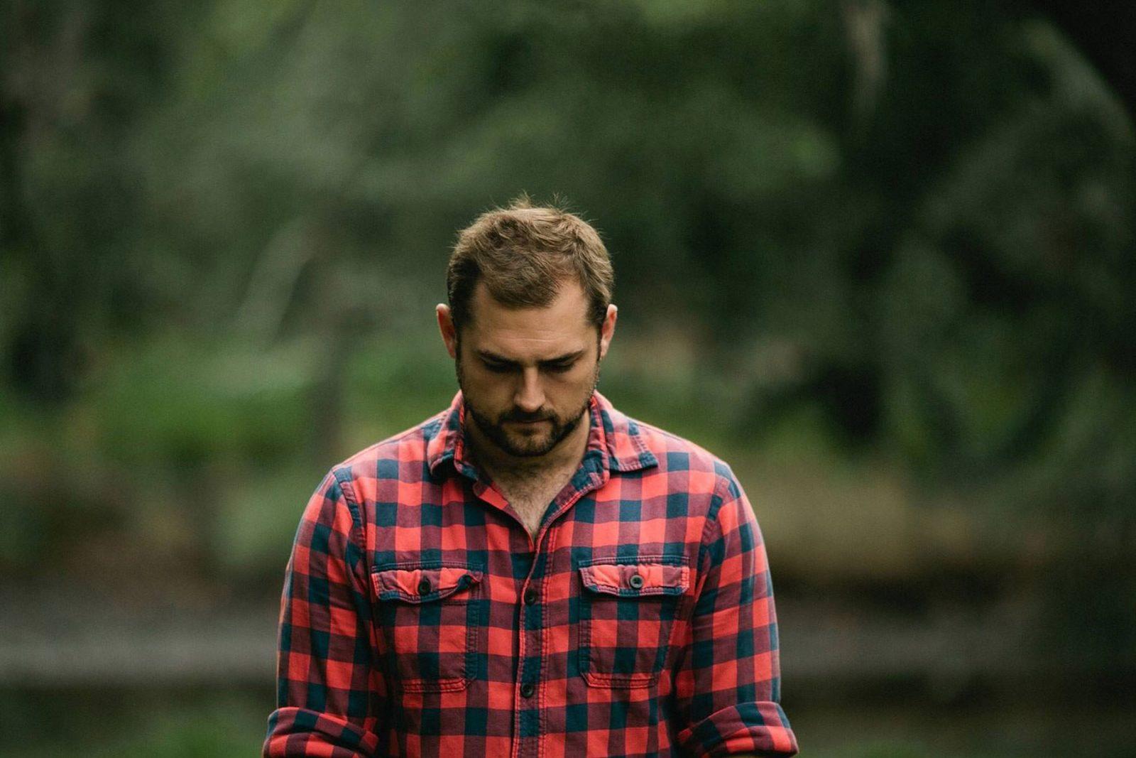 Man walking looking dejected