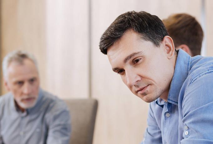 Men sat talking in a behaviour change group setting