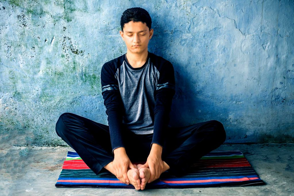 Young man doing a breathing exercise